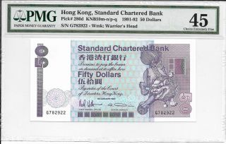 Standard Chartered Bank - $50,  1991.  Pmg 45.  Crown Logo. photo