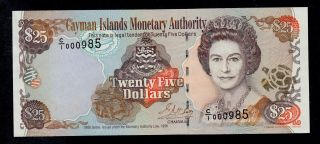 Cayman Islands 25 Dollars 1998 C/1 Low 000985 Pick 24 Unc -.  Banknote. photo