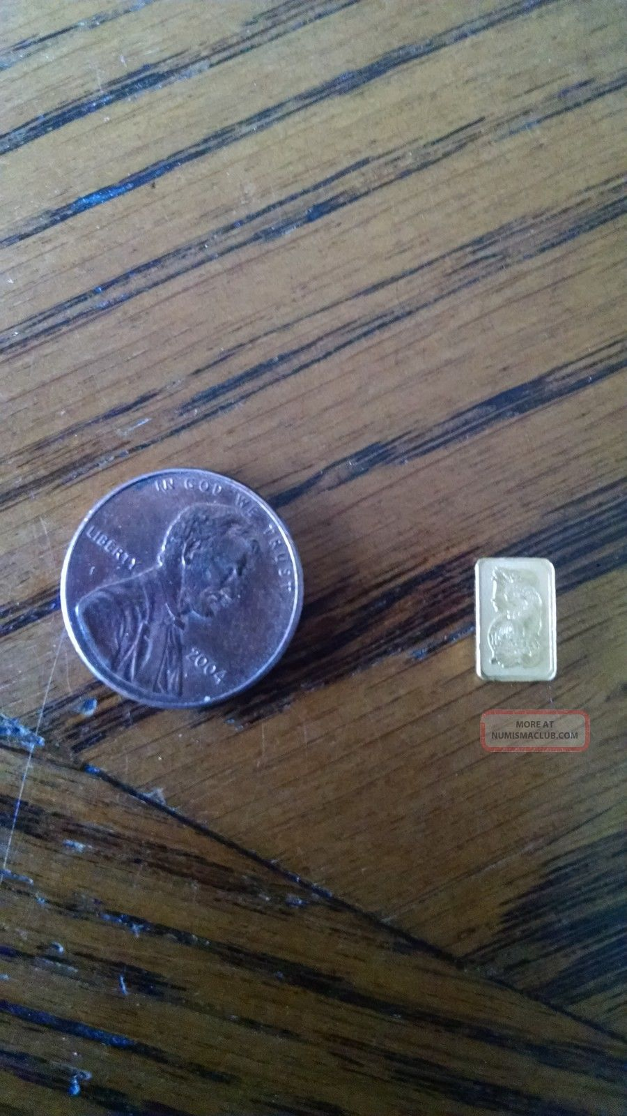 1gram Of.  999 Pure Gold Assay Gold photo