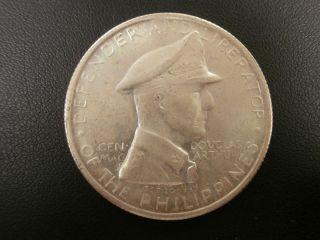 1947 - S Douglas Macarthur Philippines One Peso.  900 Silver photo