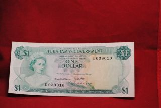 Bahamas Currency: 1.  00 1965 About Uncirculated - Discounted photo
