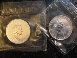 Pair (2) Canada $5 Silver Maple Leafs.  Each Is 1 Troy Oz.  9999 Pure Silver.  Gem photo