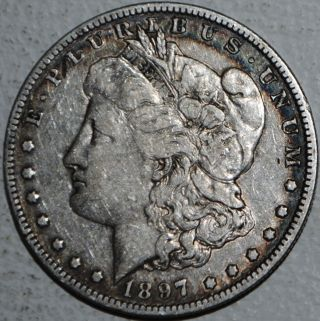 1897 O Morgan Silver Dollar $1 Coin United States. photo