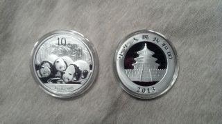 8 - 2013 Silver Chinese Panda 1 Oz Coin photo