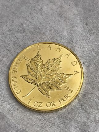 1990 1 Oz Canadian Gold Maple Leaf Coin photo