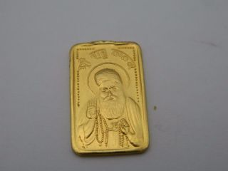 24 K.  999 Fine Gold 5 Gram Bar.  From India Religious Bar Hindu Acid photo