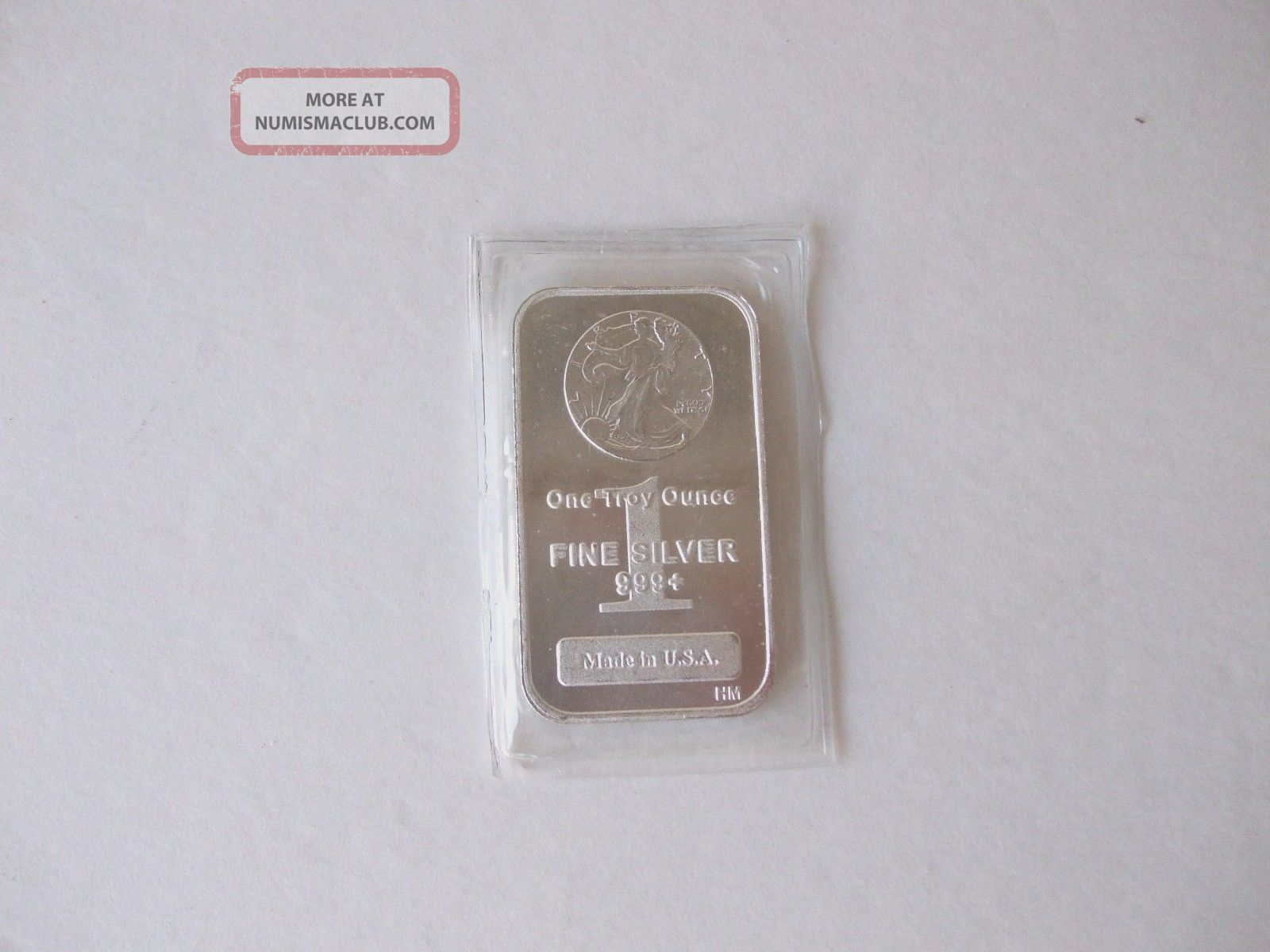 One Troy Oz.  999,  Fine Silver Bar With An American Walking Liberty Stamped In Silver photo