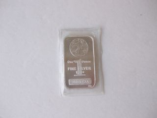One Troy Oz.  999,  Fine Silver Bar With An American Walking Liberty Stamped In photo