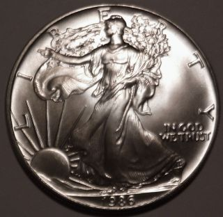 1986 American Silver Eagle 1 Oz.  999 Silver 1st Year Inaugural Issue Coin Bu photo