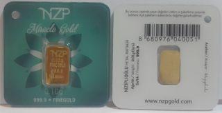 World Smallest Gold 0.  10 Gram Gold Bar 24 Karat 999,  9 Nzp Gold Int.  Sertificated photo