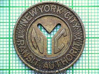 York City Transport Authority Transit Token Nyc Cut Out Y,  Good For One Fare photo