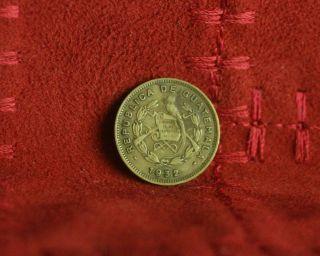 1932 Guatemala 1/2 Centavo Brass World Coin Km248.  1 Quetzal Bird Crossed Swords photo