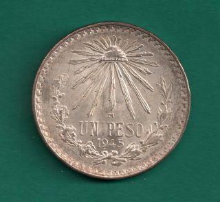 1945 Mexico Peso Unc.  7200 Silver Net.  3856 Oz.  Asw Liberty Cap Rays Reverse photo