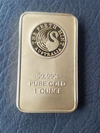 Perth 1 Oz Gold Bar Contains 1 Ounce Of 99.  99 Fine Gold. photo