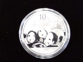 2013 China 10 Yuan.  999 1 Ounce Silver Panda In Capsule photo