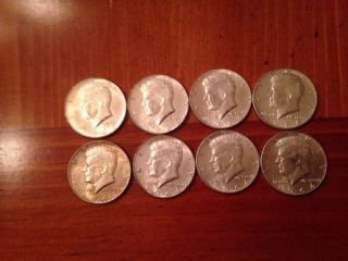 Eight 1964 Half Dollars photo