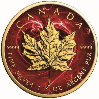 Canada Silver Maple Leaf Coin Passion Red Colorized And Gold Gilded Golden photo
