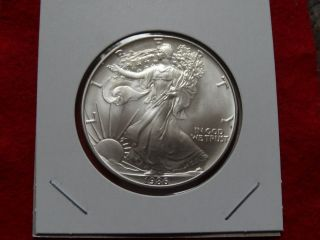 1986 American Unc, .  99.  9 Silver Eagle Dollar 44 photo