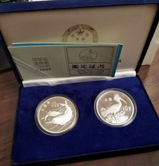 1988 China Wildlife Dolphin And Ibis 10 Yuan Sterling Silver Proof White Haze photo