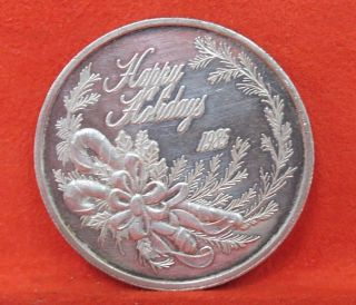 1985 Happy Holidays One Troy Ounce.  999 Fine Silver 1oz Round Coin photo