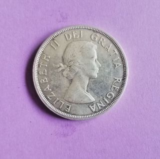 1960 Canadian Voyager Silver Uncirculated Dollar. photo
